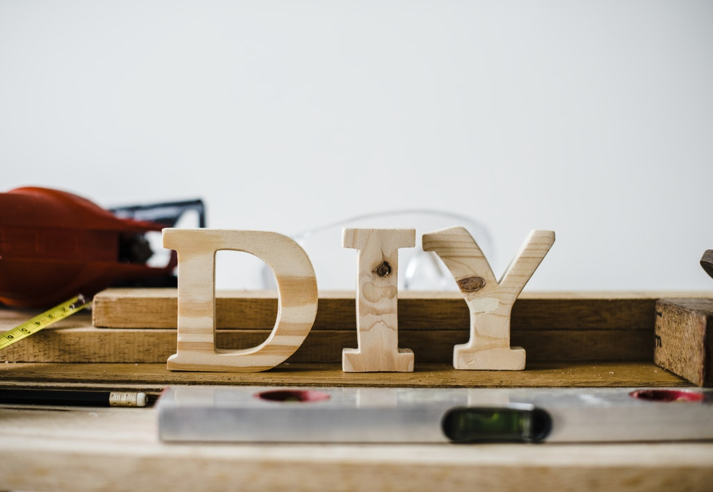 the word DIY in wooden letters