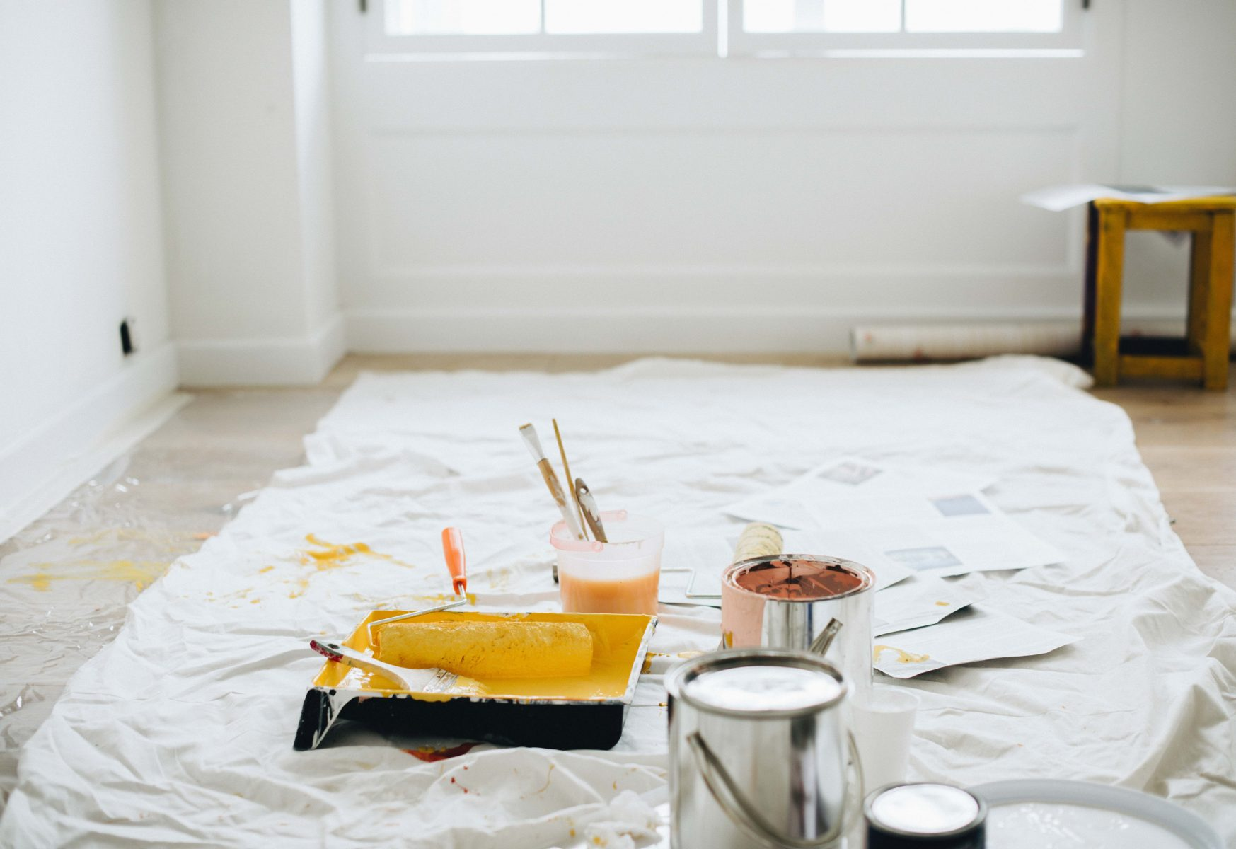 photo of painting tools and cans of paint - home renovation tips