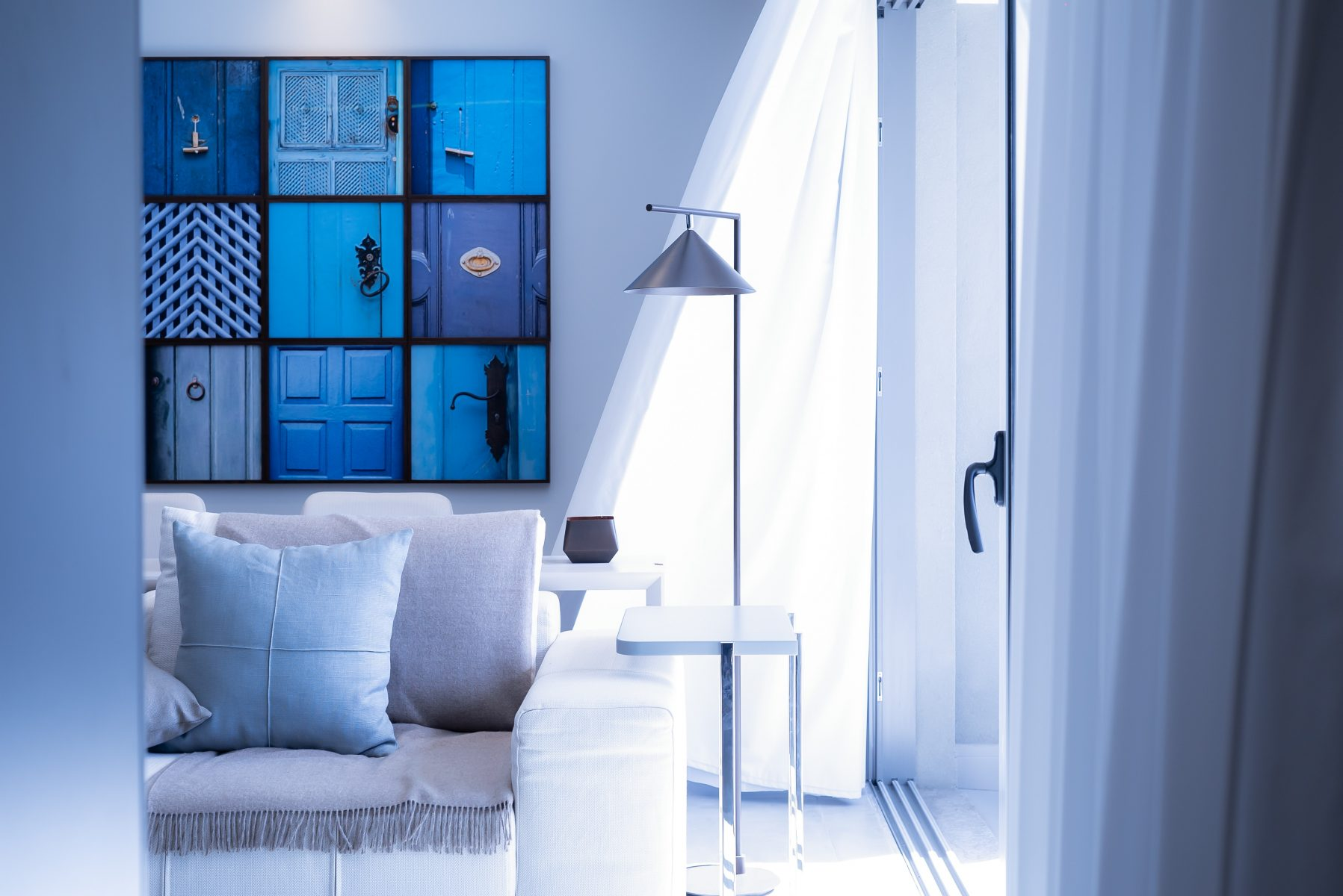 photo of a contemporary design living space with blue theme - home renovation tips